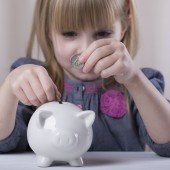 Child and piggy bank