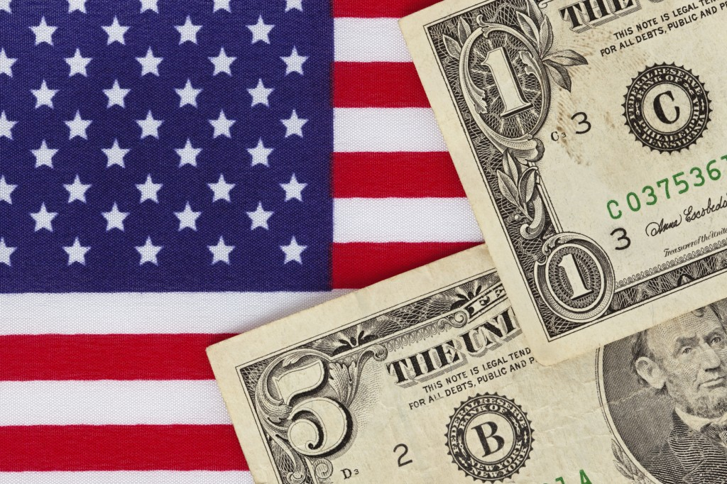 American dollar bills on a Stars and stripes flag