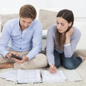 Couple Calculating Budget At Home