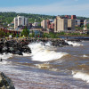 """Photo of Duluth, MN, as the waves of Lake Superior crash against the rocks."""