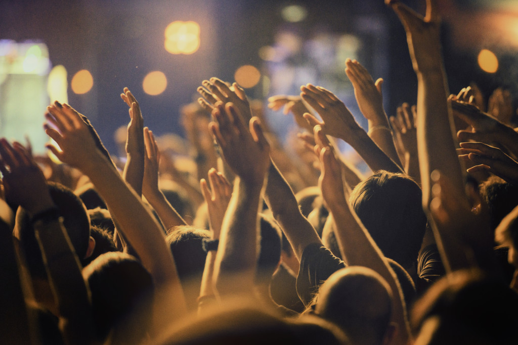 Raised hands at a concert.