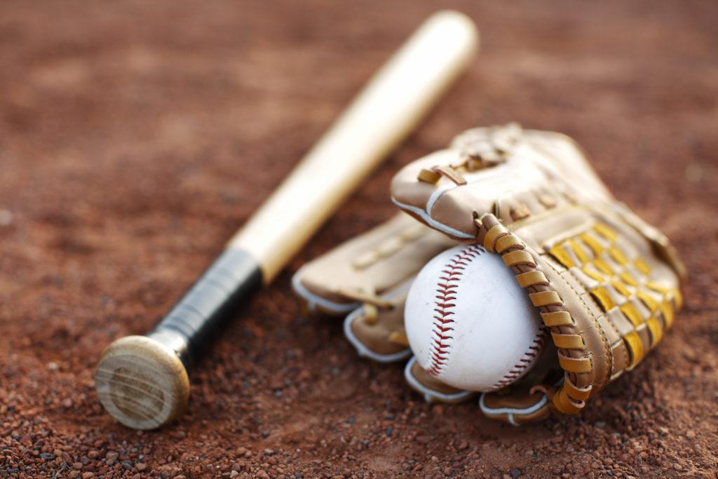 baseball, glove and mitt on baseball field
