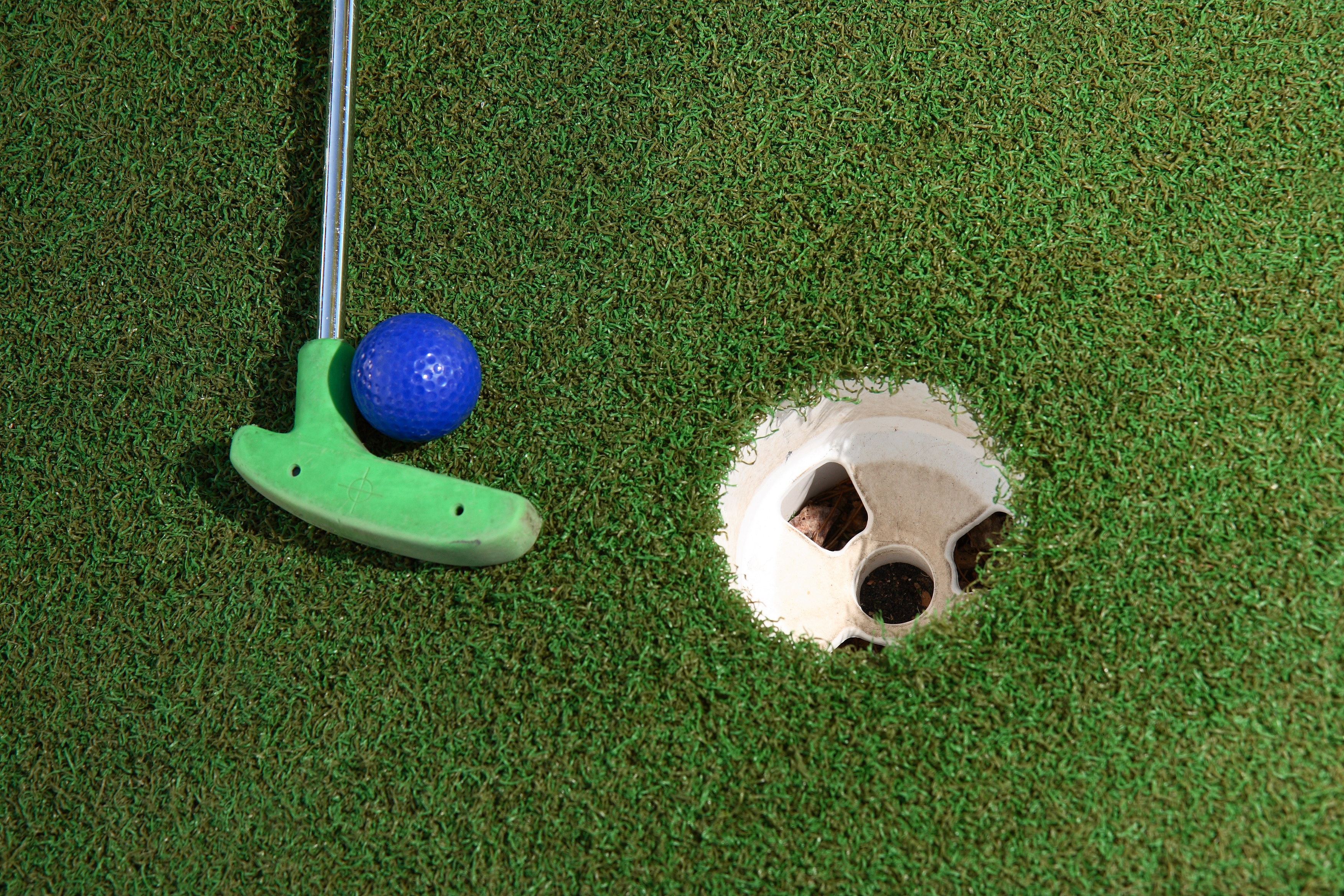"""""""Green putter, blue ball and a white cup. It's all about miniature golf"""