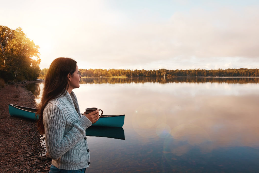 Cropped shot of an attractive young woman spending time alone by the lake
