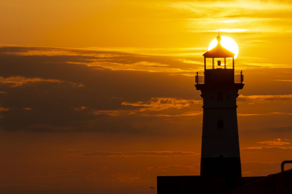 A breakwater lighthouse on Lake Superior at sunrise.