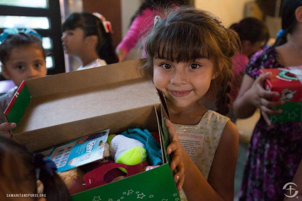 Girl holding a samaritans purse shoebox