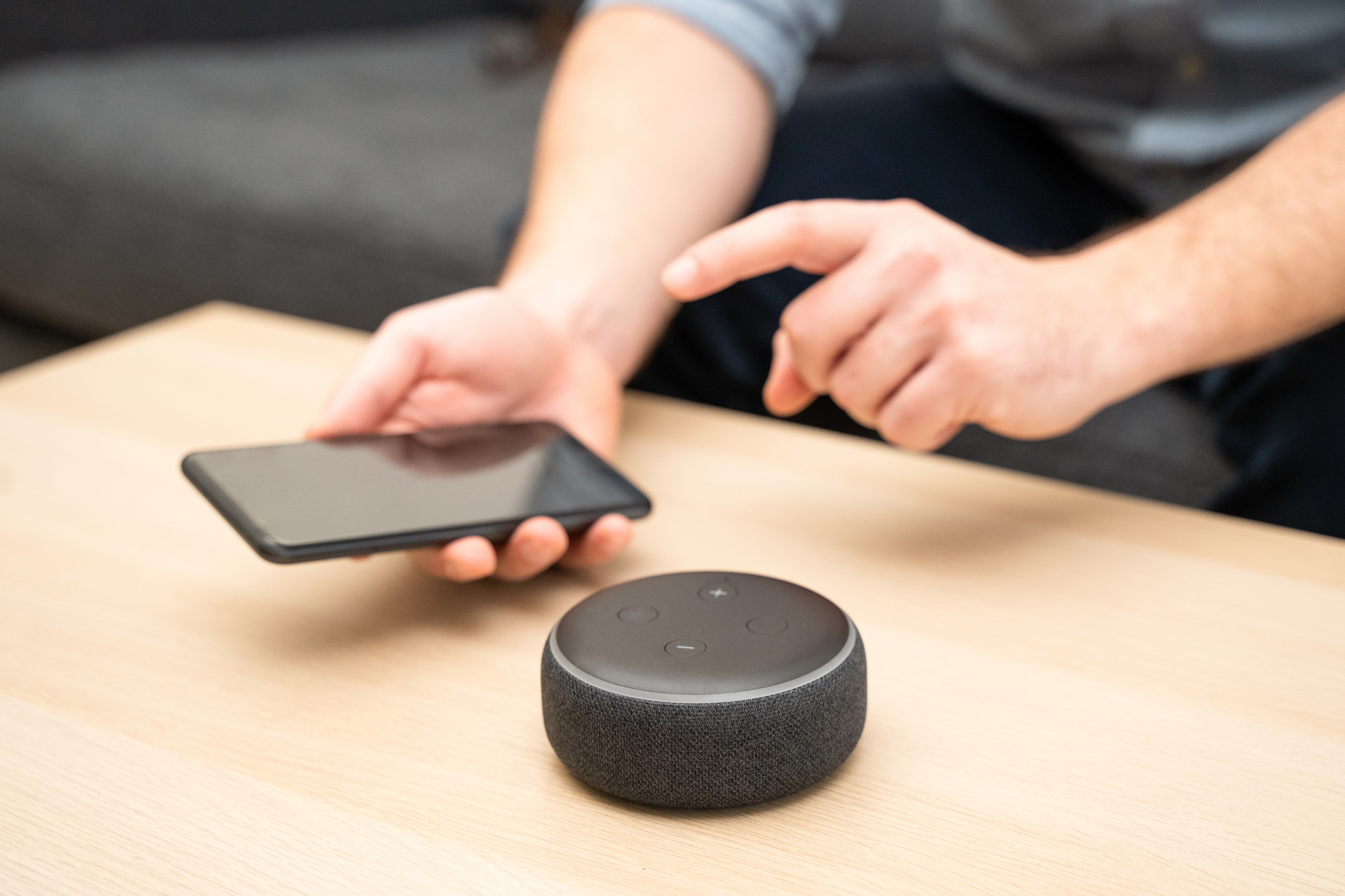 Man using home assistant bluetooth speaker